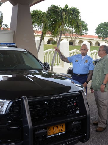 Guam Police Department Chief Joseph Cruz speaks with