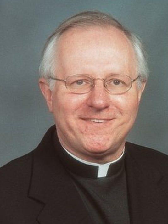635761858910482190-priest-Troy-Catholic-priest-1-1-DS474O6R-L231344711