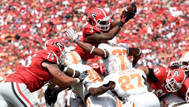 Todd Gurley leaps over the Tennessee defense for a Georgia touchdown.