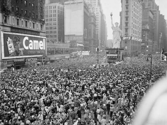 Thousands jammed New York's Times Square after President Harry Truman announced Japan's unconditional surrender on Aug. 14, 1945. There's a replica of the Statue of Liberty.