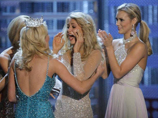 FILE -- Miss Michigan Kirsten Haglund, center, reacts as she is named Miss America 2008 during the Miss America Pageant at the Planet Hollywood hotel and casino in Las Vegas, Saturday, Jan. 26, 2008. (AP Photo/Jae C. Hong)