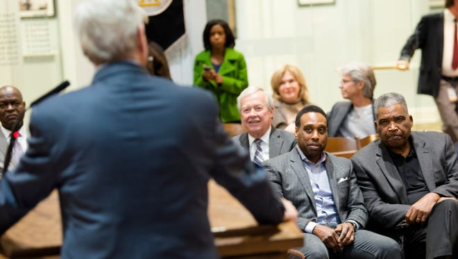Montgomery School Board chairman Robert Porterfield, right, looks on as Mayor Todd Strange speaks during a press conference on Thursday, Jan. 11, 2018, in Montgomery, Ala. The press conference was held to discuss on the state of the Montgomery Public School system.