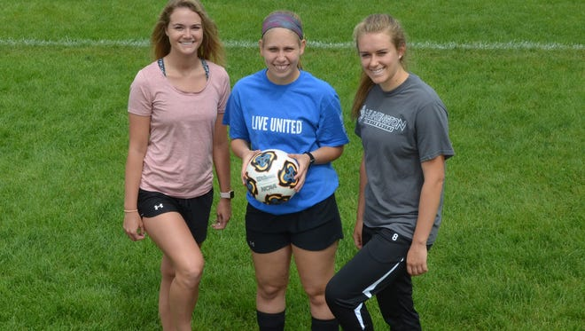 Pennfield senior captains, from left,  Lexi Westerman, MeKenzie Lamb and Megan Smith have helped the Panthers to the school's first city title in girls soccer.