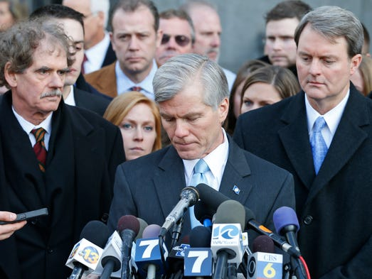 Former Virginia Gov. Bob McDonnell, center, composes