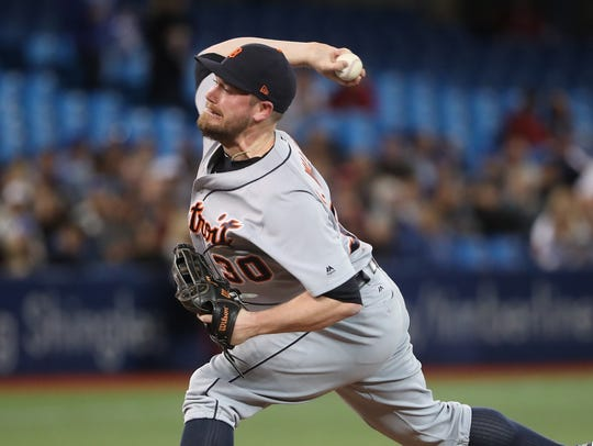 Tigers pitcher Alex Wilson delivers a pitch in the