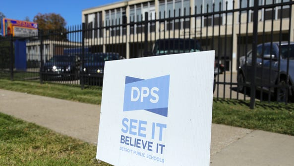 A sign for Detroit Public Schools is posted outside