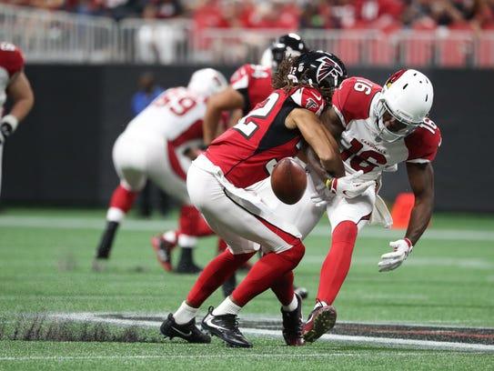 Cardinals receiver Chad Williams (16) lost a fumble