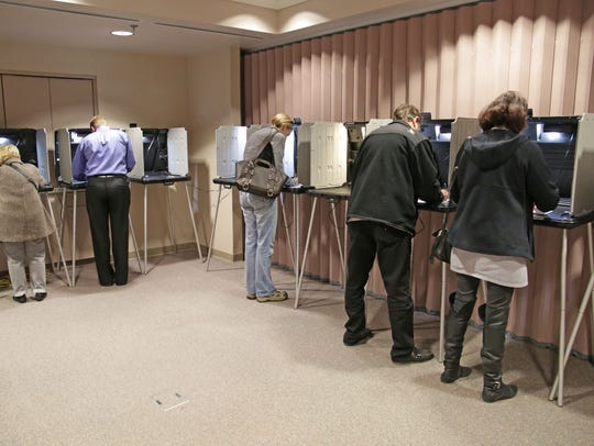 Wisconsin voters participating in early voting in the