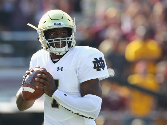 Notre Dame QB Brandon Wimbush looks to pass in the first half against Boston College on Sept. 16, 2017 in Chestnut Hill, Mass.