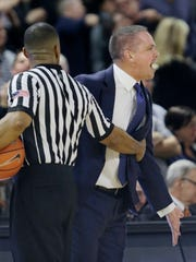 Butler head coach Chris Holtmann has to be restrained by a referee after his team was called for a foul late in the second half of their NCAA college basketball game against Providence Saturday, Feb. 11, 2017, in Providence, R.I. Providence defeated Butler 71-65 in a come from behind win. (AP Photo/Stephan Savoia)