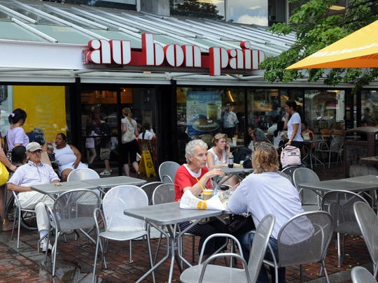 People sit at  the original Au Bon Pain in Harvard Square July 30, 2009 Cambridge, Mass.