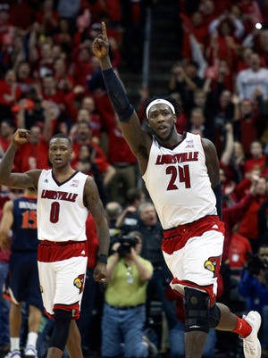 With only seconds left on the clock, Louisville's Montrezl Harrell (#24) and Terry Rozier can feel victory over #2 ranked Virginia is in reach.  March 7, 2015