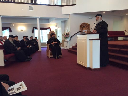 Father Antonios Tanious addresses the congregation during the celebratory service on Saturday, Aug. 1, as His Grace Bishop Karas, Patriarchal Exarch at the Coptic Orthodox Archdiocese of North America, and other Coptic Orthodox priests from throughout New Jersey and New York look on.