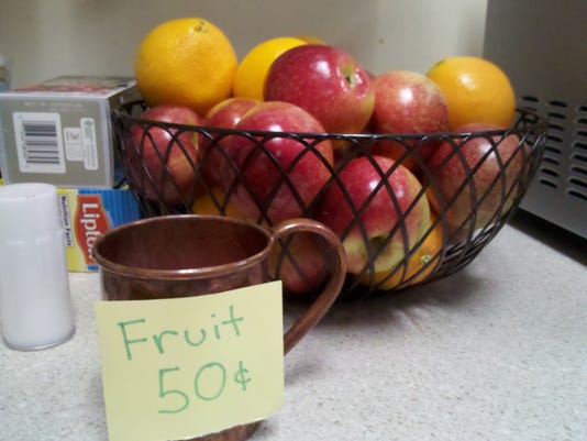 This fruit bowl provides a healthy snack option for York Daily Record/Sunday News and York Newspaper Company employees. Nutrient-dense foods provide people with more energy, versus nutrient-deficient foods -- such as processed chips, cookies, candy -- which cause a spike in blood sugar, a crash in energy and a craving for more.  Photo by Leigh Zaleski.