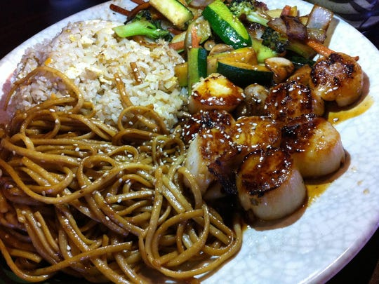 The hibachi scallop dinner at Hokkaido on Merritt Island was a gigantic plate of food that included both noodles and fried rice as well as vegetables, preceded by soup and salad.