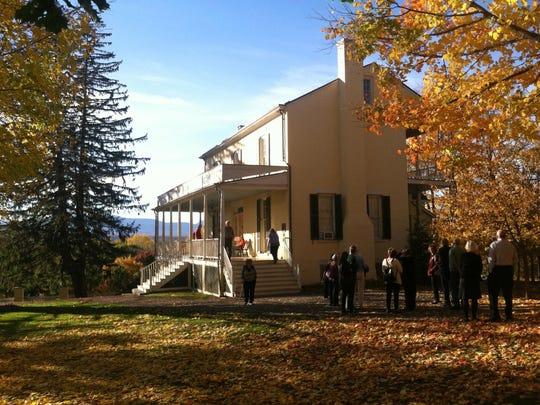 Visitors tour the house at the Thomas Cole National Historic Site in Catskill, N.Y.