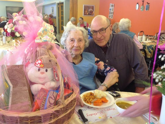 Helen Urban and her son, John, celebrate her 102 birthday Monday at Our Lady of Providence Assisted Care Facility in Winooski.
