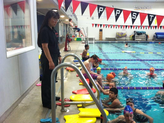 Patty Jenkins lead practice for the Poulsbo Piranhas Swim Team on Tuesday.