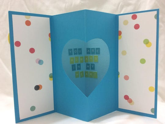 With a few folds and a cutout heart, a message to your valentine shines in this card.