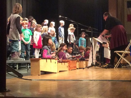 Students perform a German folk song at Edmunds Elementary