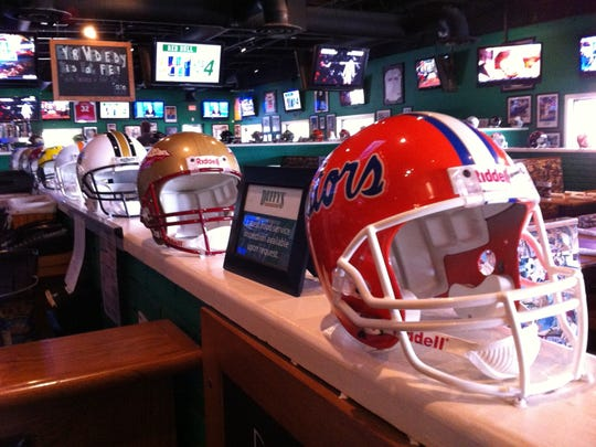Television screens spread across the length and breadth of the Duffy's, interspersed with memorabilia and college and pro football headgear.