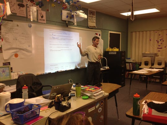 In less than a year, Andy Grab has transitioned from high-tech worker at IBM to math and science teacher. In this photo Grab does his student teaching at Browns River Middle School in Jericho.