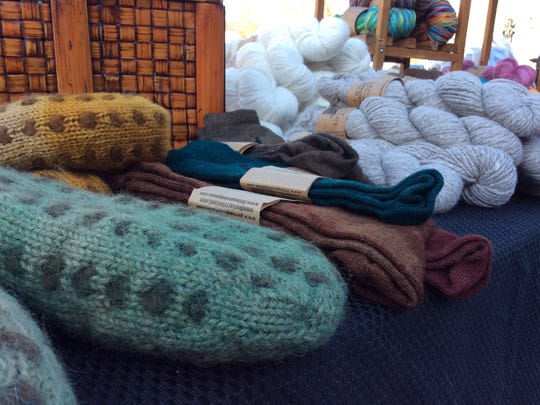Wool socks from fiber raised at Little Patch Alpacas are just one of the many offerings at the Oxford Farmers Market.