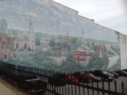"The ""Bursting With Pride"" mural on Franklin Street also should be the subject of discussions about restoration, say those looking at preserving Clarksville's ghost ads."