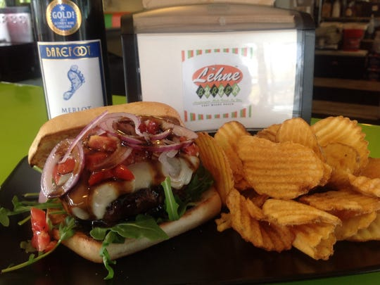 """A loaded burger and chips from Lehne Burger on Fort Myers Beach, which features a """"build your own"""" style burger menu."""
