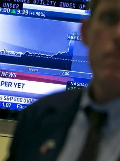 A television monitor on the New York Stock Exchange floor shows the Fed's Sept. 18 decision not to start tapering its stimulus of the U.S. economy.