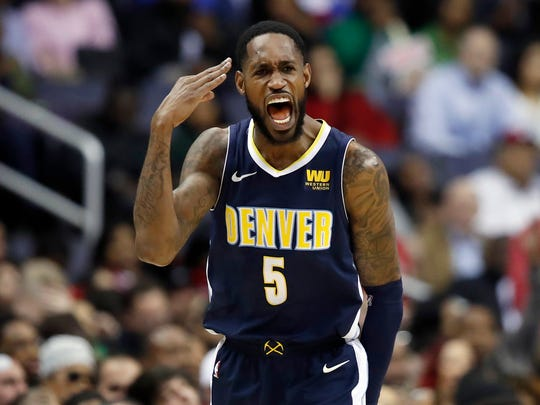 Denver Nuggets forward Will Barton celebrates his three-point basket during the second half of an NBA basketball game against the Washington Wizards, Friday, March 23, 2018, in Washington. (AP Photo/Alex Brandon)