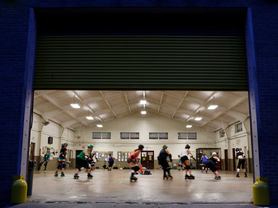 """Capital City Roller Girls practice at the Brandon Armory on May 11. """"When I put on my gear (for a game), I feel like I become a different person,"""" says Jamie Sclafani, 24, who works as an office manager at a cold storage facility."""