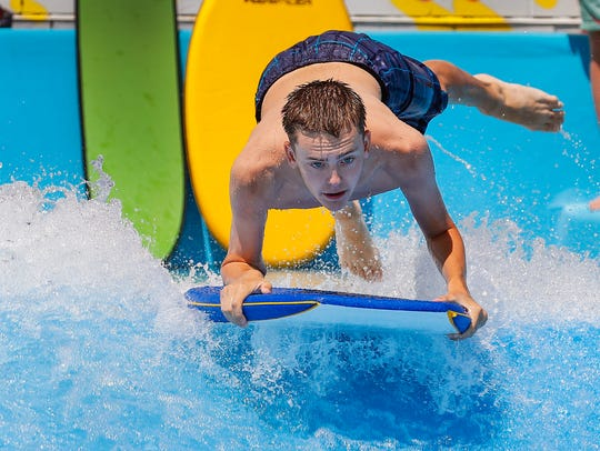Kids try their hand riding FlowRider at The Waterpark at the Monon Community Center in Carmel is a 3.5-acre aquatic experience. Surf the waves on the FlowRider, scale the wall of the AquaClimb and ride down the lazy river.