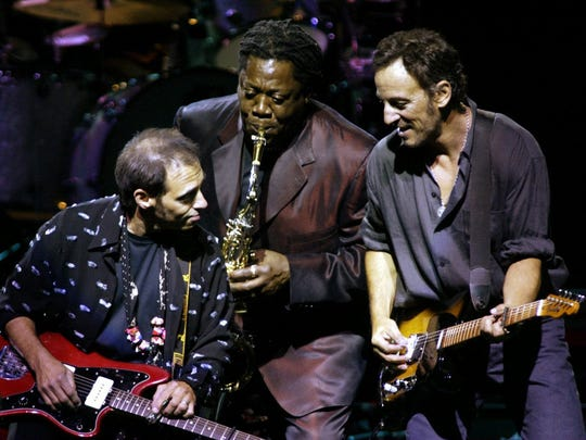 Bruce Springsteen plays with Nils Lofgren and Clarence Clemons on Aug. 7, 2002, at Continential Airlines Arena in East Rutherford.