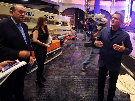 Matt Crouch, Chairman & CEO of TBN, right, and Mike Huckabee, far left, show off the set for Huckabee's upcoming show as its construction was being completed October 2, 2017.