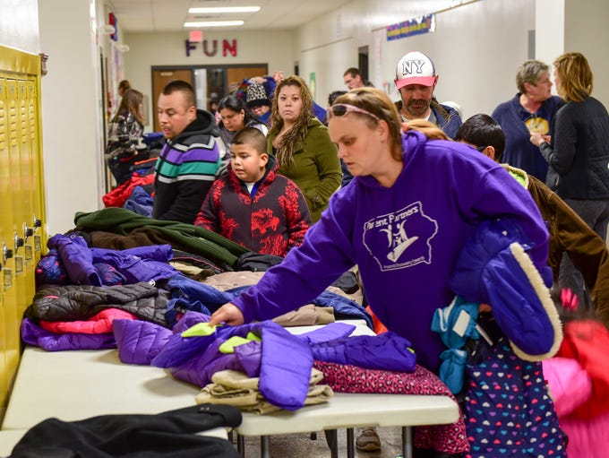 Party goers check out the free coats on Thursday, December