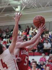 Loudonville's Austin VanSickle drives to the basket during their game Friday night at Mansfield Christian.