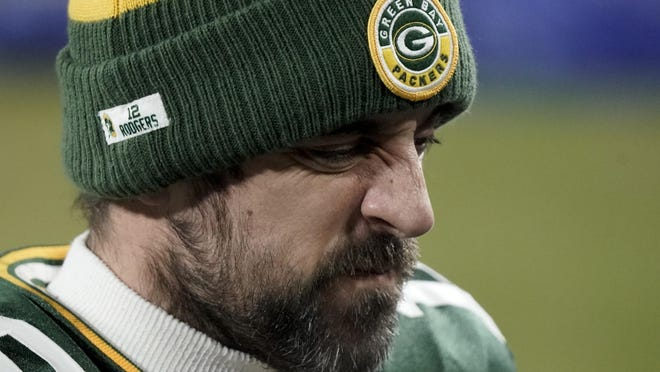 Green Bay Packers quarterback Aaron Rodgers (12) walks off the field after the NFC championship NFL football game against the Tampa Bay Buccaneers in Green Bay, Wis., Sunday, Jan. 24, 2021. The Buccaneers defeated the Packers 31-26 to advance to the Super Bowl.