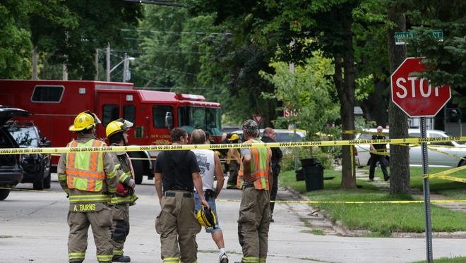 Emergency personnel respond Friday to the scene of a shooting in New London.