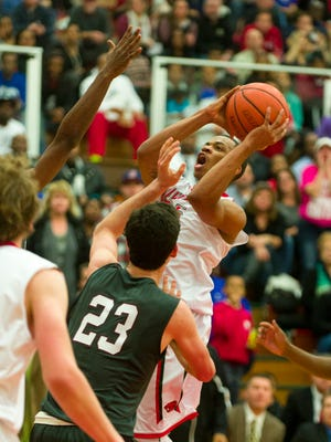 Lawrence North High School senior Pat Bacon (25) puts up a shot during the second half of action. Lawrence North hosted Lawrence Central in boy's varsity basketball, Wednesday, Dec. 10, 2014. Lawrence North defeated Lawrence Central 66-48 to take back the Lawrence Township Traveling Trophy.