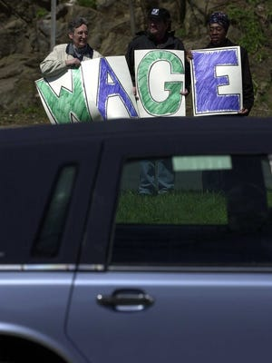 """A """"human billboard"""" advocating an increase in the minimum wage on Central Avenue in Yonkers in 2004."""