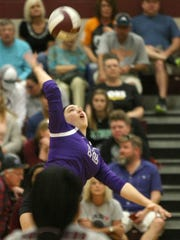 Trinity Christian Academy's Maggie Brooks (12) hits the ball during the West Tennessee All-Star Volleyball Game on Saturday.