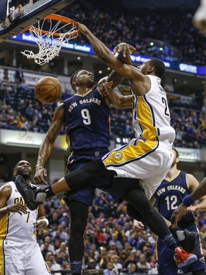 Indiana Pacers forward Thaddeus Young (21) dunks over New Orleans Pelicans forward Terrence Jones (9) in the first half at Bankers Life Fieldhouse on Monday, Jan. 16, 2017.