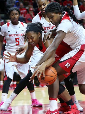 Ohio State guard Kiara Lewis, and Rutgers center Victoria Harris, right, vie for the ball during the first half of an NCAA college basketball game Sunday, Feb. 26, 2017, in Piscataway, N.J. (AP Photo/Mel Evans)
