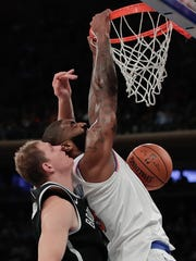 New York Knicks center Kyle O'Quinn (9) dunks the ball