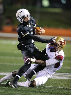 South Brunswick quarterback Felix Quinones gets tackled by Hillsborough's Jackson Parham in the first half of their Central Group V quarterfinal on Friday, Nov. 10, 2017.