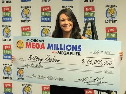 Her check for the mega millions jackpot photo michigan lottery