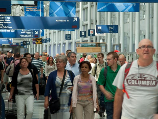 636021394094655051-Courtesy-Chiago-O-Hare-Airport---busy-day.jpg