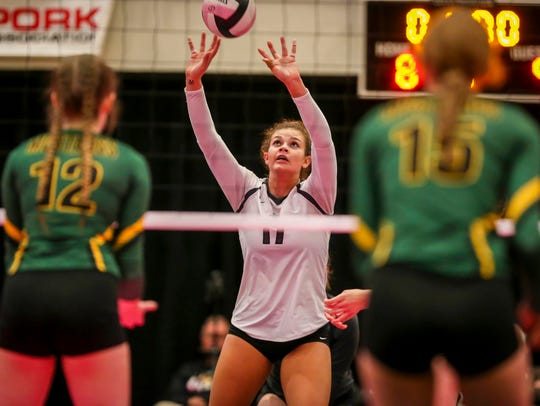 Ankeny Centennial's Ari Winters sets the ball against