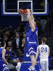 Covington Catholic's Jake Walter, 44, dunks against